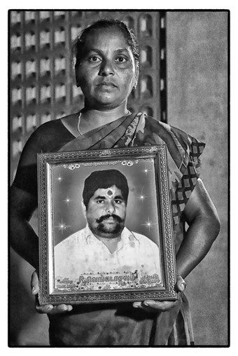 Amuda with photo of her husband R.  Venkatachalam, a debt-stressed tenant farmer, village Keelaiyur, Tamil Nadu. Venkatachalam 'died due to heart attack' with an outstanding loan of $2810.