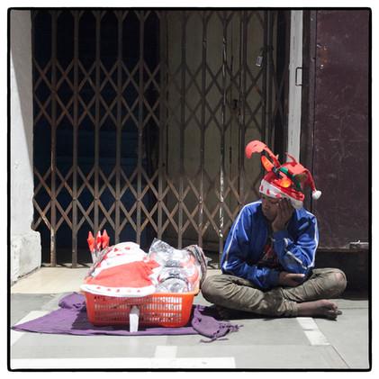 Teenage seller awaits customers.