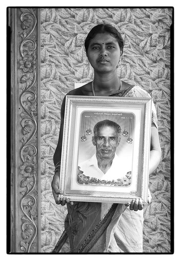 Vasanthi with photo of her father, a debt-stressed farmer from Nagapattinam, Tamil Nadu, who 'died due to heart attack.'