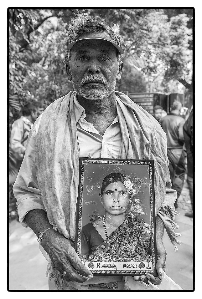 Ramanna with photo of his deceased wife R. Venkatamma, both farmers in Andhra Pradesh. Venkatamma committed suicide over an unpaid loan of $ 8428.
