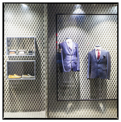 Show window of an upscale clothing store.