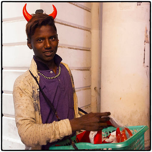 12 Teenager Selling Horns and Santa Caps