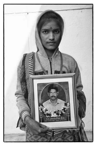 18-year old Vennela Vankudothu with photo of her deceased tenant farmer father, Thenda village, Telengana. Srinu committed suicide over an unpaid debt of $ 18,263.