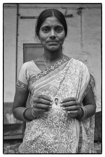 Rajitha with photo of her deceased husband P. Ramesh, tenant farmer, Bhupalpalli village, Telangana. Ramesh committed suicide over unpaid debt of $ 3231.