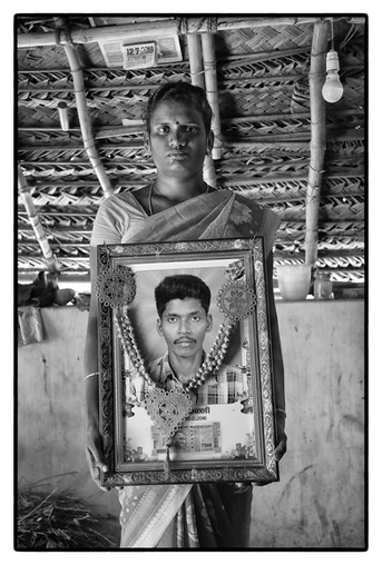 Kavita with photo of her deceased husband Veeramani, a debt-stressed tenant farmer in Tamil Nadu. He 'died of heart attack' at the age of 30.