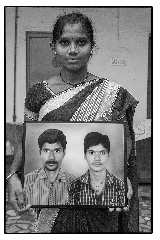 D. Latha with photo of her deceased husband D.P. Raju (left) and his brother, Chilpuru village, Telengana. Both committed suicide over an unpaid loan of $ 3500.