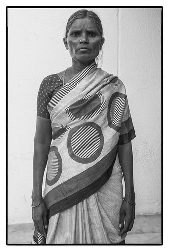 Widow of a farmer from Andhra-Telengana region. Her husband – a tenant farmer was unable to pay back a farm loan and committed suicide. She did not have even his photo.