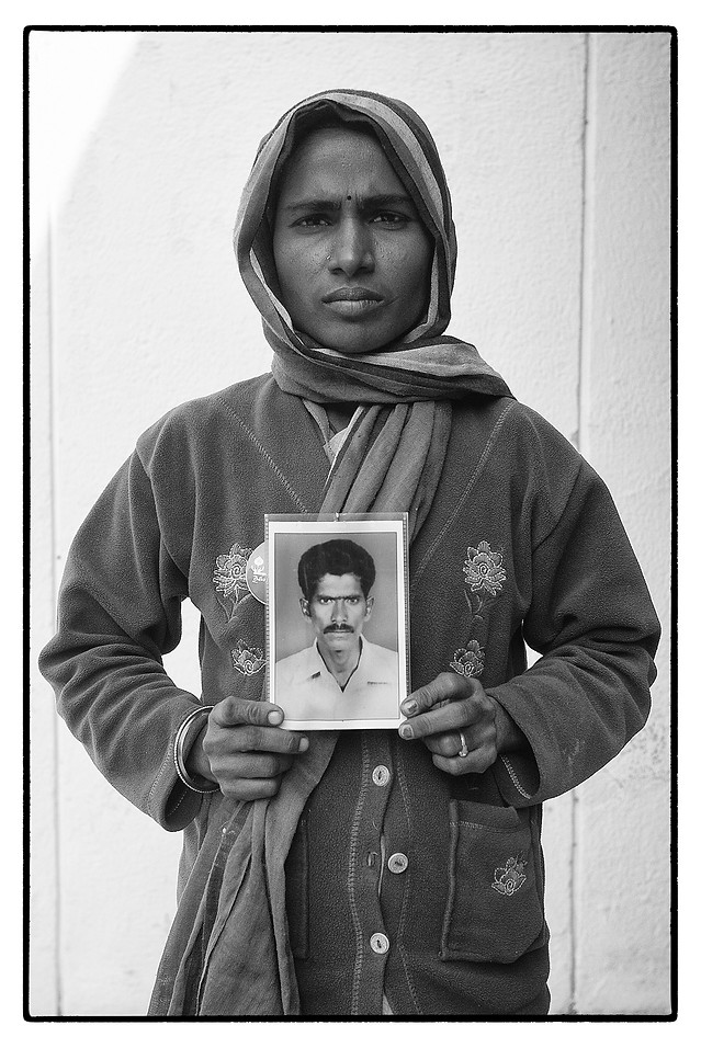 Yadamma with photo of her deceased husband M. Mallayya, Mallareddypalli village, Telengana. Mallayya, a tenant farmer, committed suicide over an unpaid debt of $ 4214.