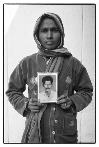 Yadamma with photo of her deceased husband M. Mallayya, Mallareddypalli village, Telengana. Mallayya, a tenant farmer, committed suicide over an unpaid debt of $ 4214.