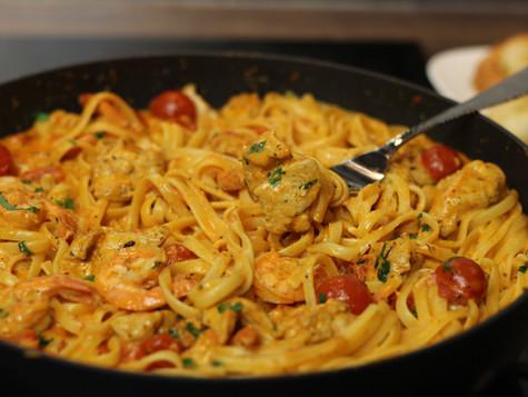 Creamy Tomato Chicken & Shrimp Pasta