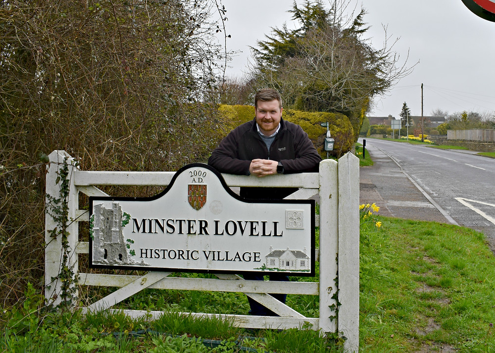 Cllr Walker at the entrance to Minster Lovell