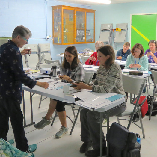PSBO Board President Christine Southwick teaches the banding course at the Willow Creek Hatchery in Edmonds in 2019.