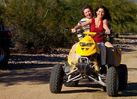 Quad riding with mom.