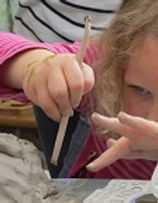 child using clay
