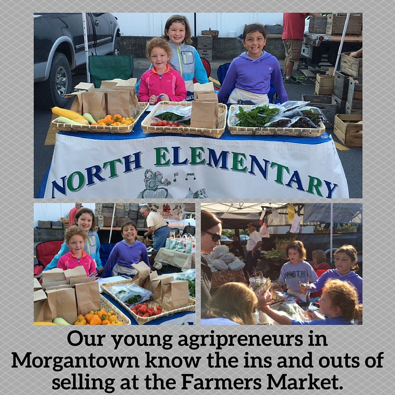 Students help customers to school-grown produce at the Morgantown Farmer's Market