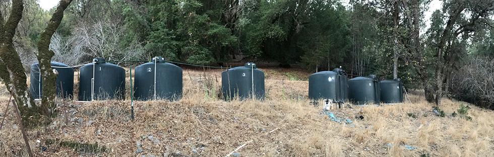 7 2500 gallon water tanks