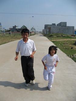 Huimin runs with dad