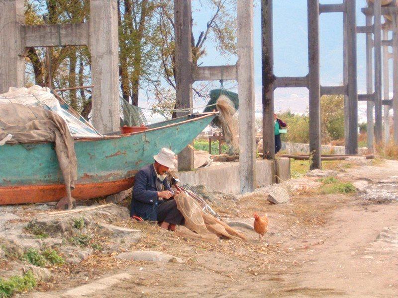 Dali fisherman mends his nets.