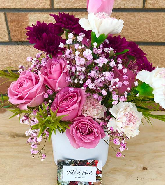 Fresh flowers in a pot – $60