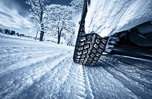 Car tires on winter road.jpg