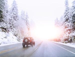 scenic veiw of empty road with snow cove