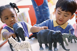 School Children Playing with Animal Toys