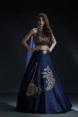 Shruti S cages lehenga blue.jpg