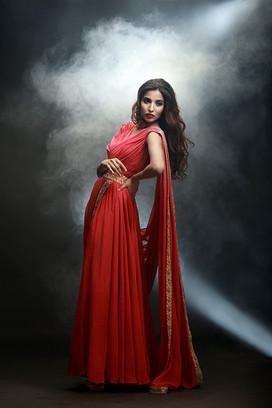 Shruti S coral draped gown.jpg