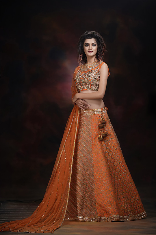 ShrutiS orange engagement lehenga.jpg