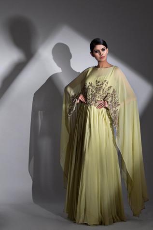 Shruti S cape gowns.jpg