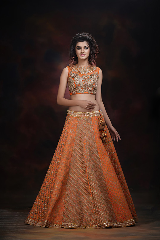 ShrutiS Orange Lehenga bridal.jpg
