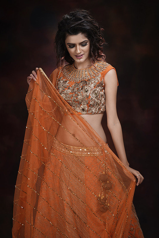 Shruti S bridal lehenga orange.jpg