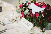 Mr and Mrs table setting with flower arr