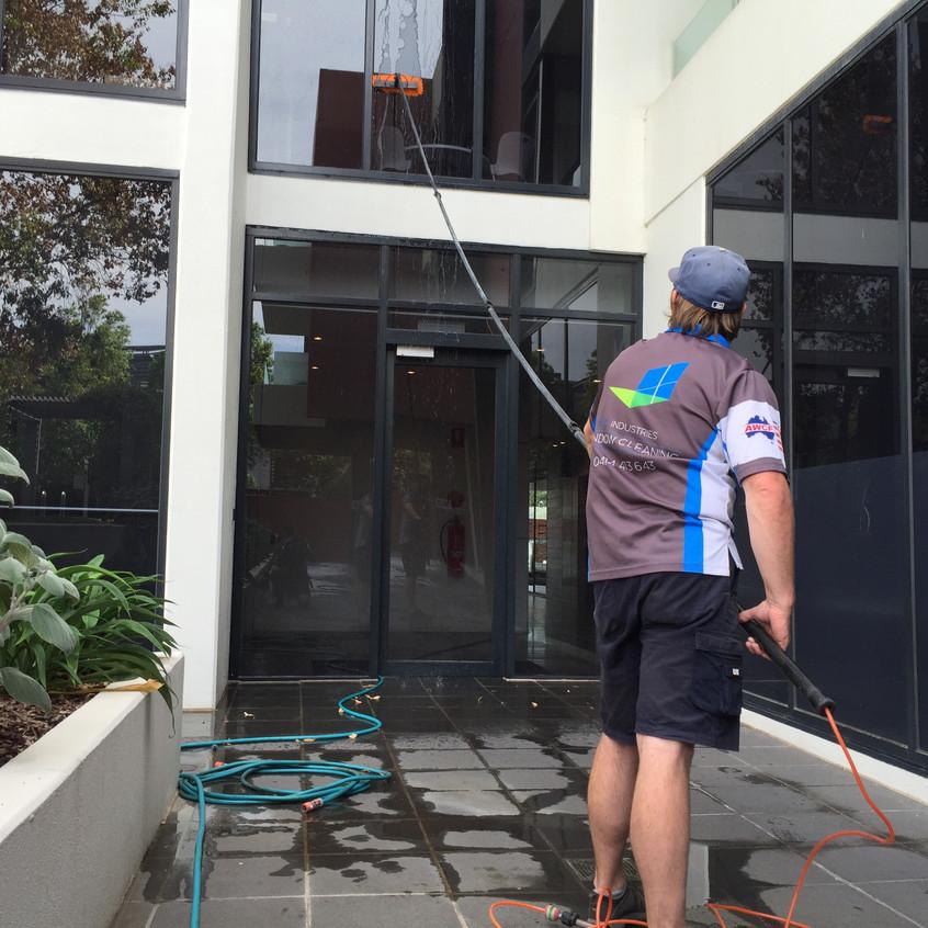 Simon on the Water Fed Pole. Super-skills.