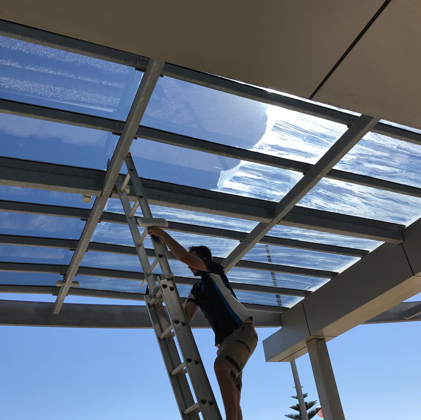 Overhead glass canopy clean.