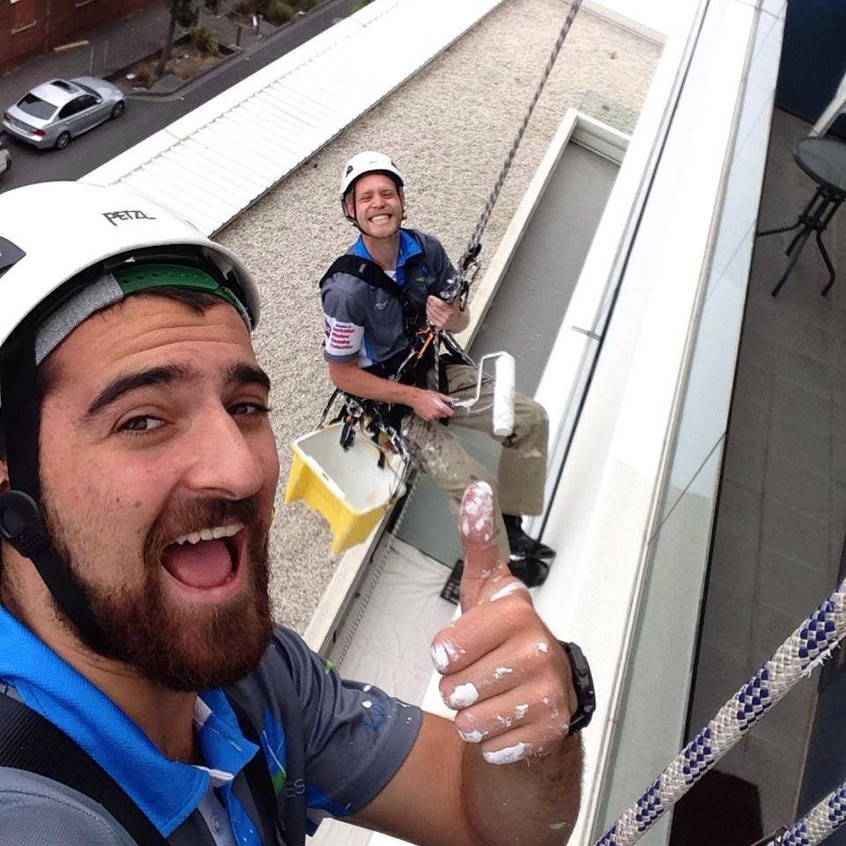 the super-models-Alex & Tom up a 10 storey painting. Alex did alright this day.