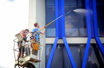 Callum and Antonio high pressure washing