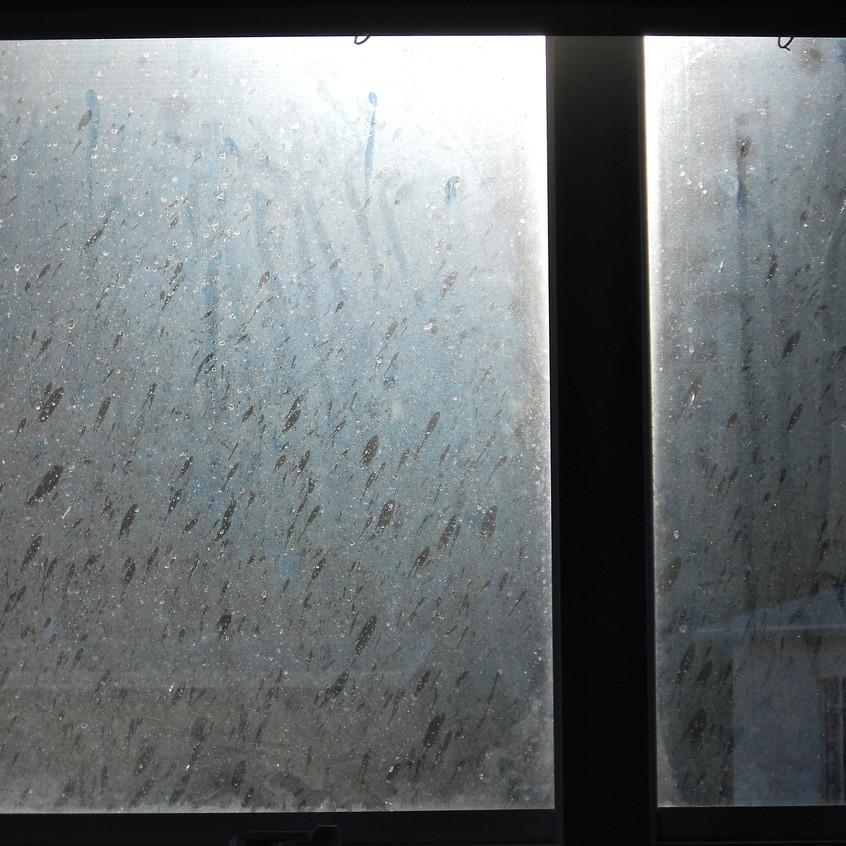 Rain on dirty glass.