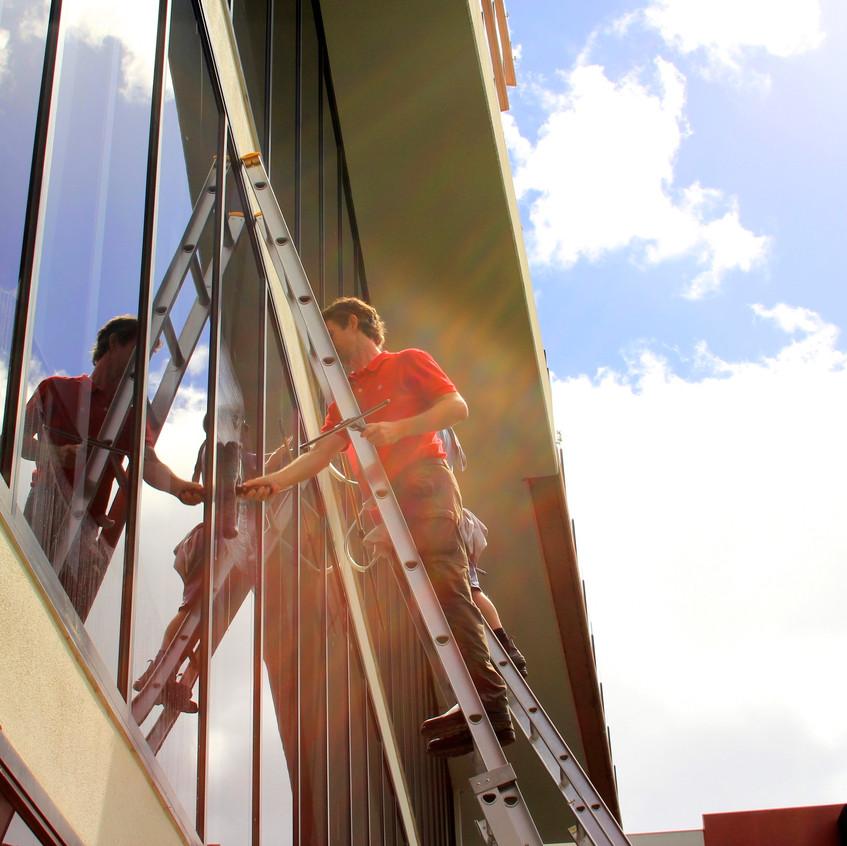 Ian & Brian up massive ladders.