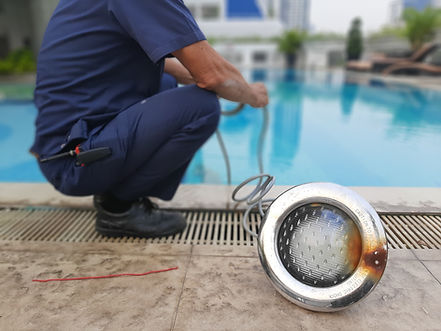 the engineering repaired electricity light for swimming pool.jpg