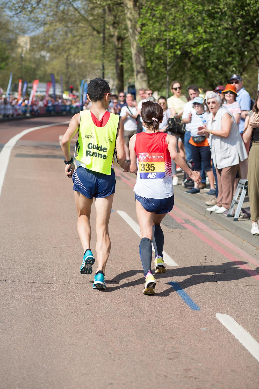 A blind athlete and guide run through Bermondsey