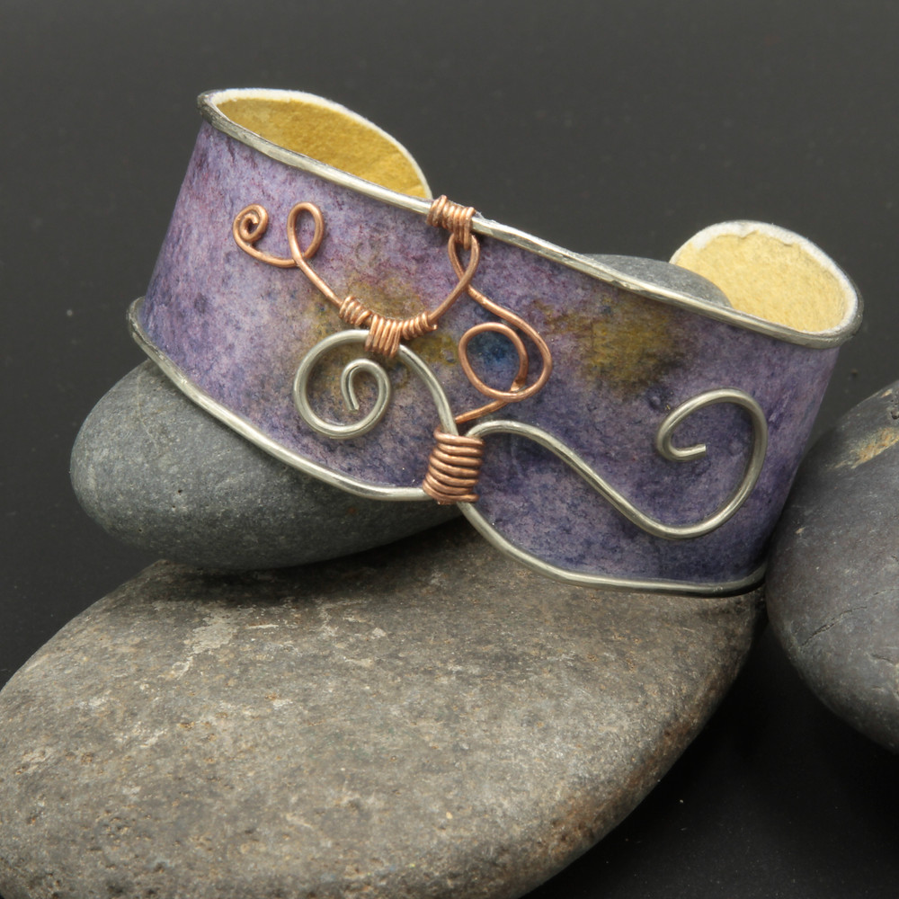 Purple watercolor band trimmed in nickel silver wire with swirls of copper.
