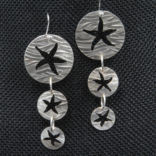 4d27a8394 Each of the three starfish in this design are hand sawn from three sterling  silver discs each textured with waves. These earrings have lots of sparkle  and ...