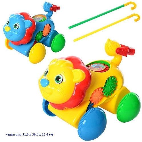 Купить игрушку каталка лев 2 цвета со звонком