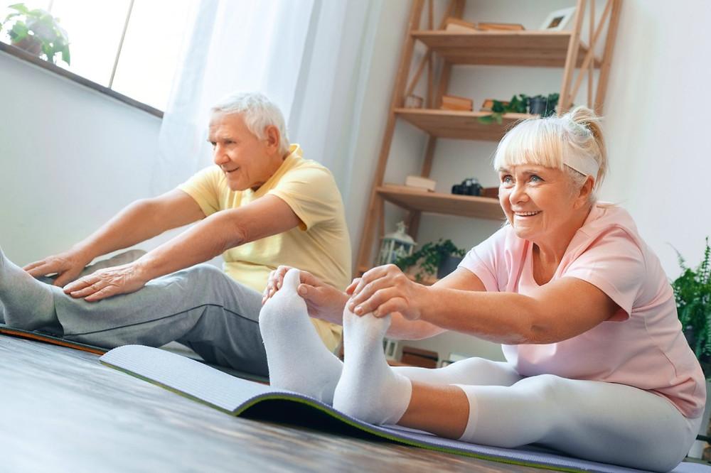 Elderly-Couple-Exercising-To-Ease-Back-Pain
