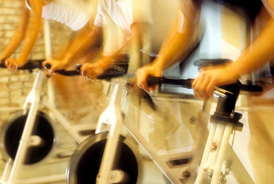 Blurred image of people in indoor bikes