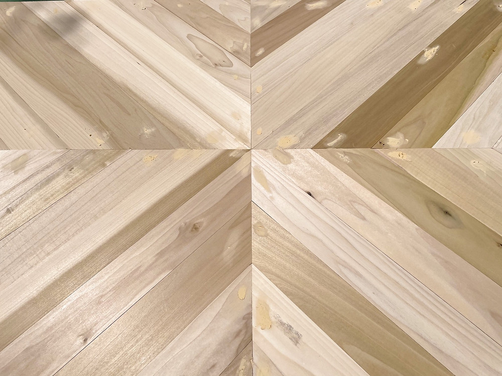 geometric countertop pattern with nail holes filled