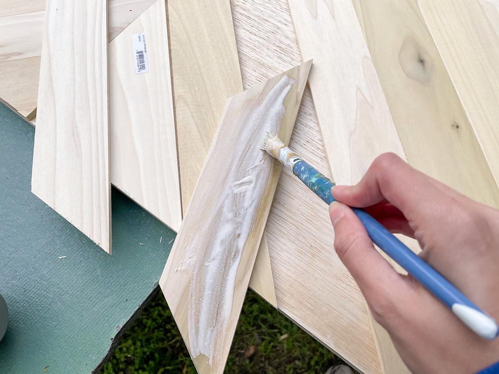 wood glue on the back of poplar board