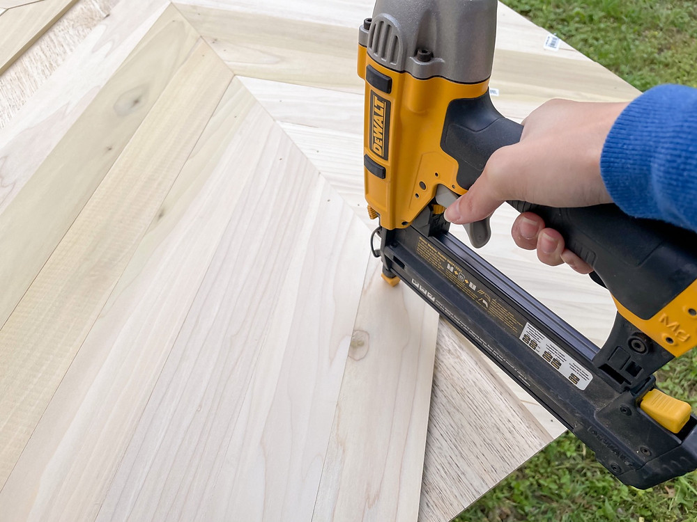 poplar board attached to plywood base with brad nailer