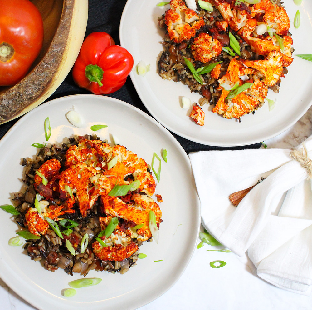 harissa covered cauliflower with wild rice tomatoes and onions